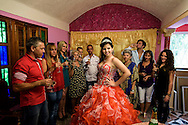 Quinze&ntilde;eras<br /> <br /> The age of fifteen years old (quince) a la Habana mark the final transition<br /> from childhood to adulthood, and as such, are celebrated today in the<br /> most sumptuous, extravagant, kitsch, megalomaniacal way possible.<br /> Some people rent a limousine and five-star hotel or hires local popstar,<br /> TV celebrities to animate the party.<br /> There are specialized photographic studios with various photographers,<br /> videographers stylists and hairdressers, or even the entire organization<br /> of the event dedicated to the celebrations for the quincea&ntilde;era.