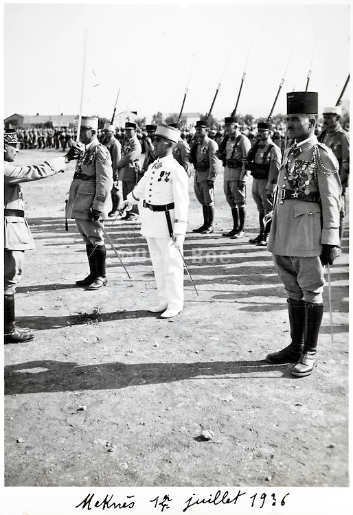 French and Moroccan army soldiers during a 14 July parade celebration 1936