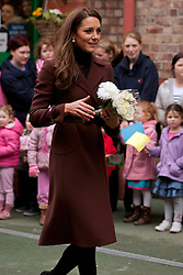 © Licensed to London News Pictures. 14/02/2012.  Liverpool, UK. The Duchess of Cambridge holds flowers given to her by children at Alder Hey Hospital. Photo credit : Ashley Hugo/LNP
