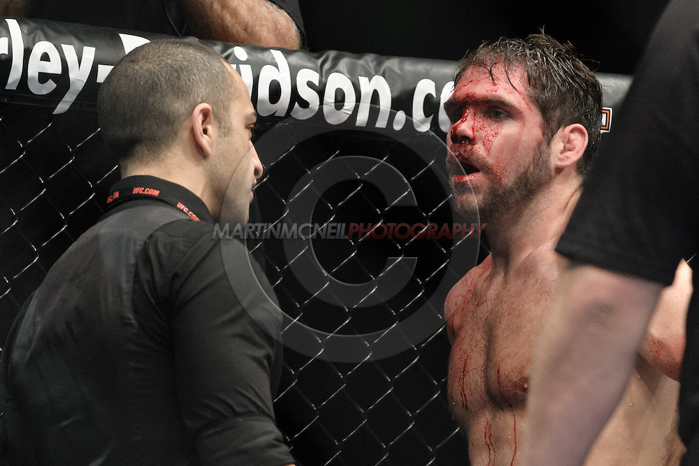 "MANCHESTER, ENGLAND, NOVEMBER 14, 2009: Aaron Riley (right) has a cut on his head examned by a medical official during ""UFC 105: Couture vs. Vera"" inside the MEN Arena in Manchester, United Kingdom."