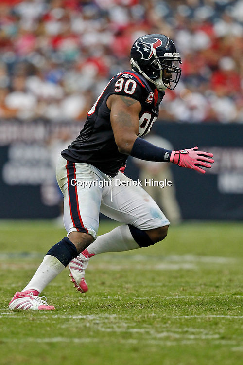October 10, 2010; Houston, TX USA; Houston Texans defensive end Mario Williams (90) pursues on a play during a game against the New York Giants at Reliant Stadium. Mandatory Credit: Derick E. Hingle