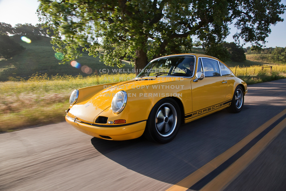 Image of a yellow 1967 Porsche 911 R Tribute car on a road in Solvang, California, American Southwest, model and property released