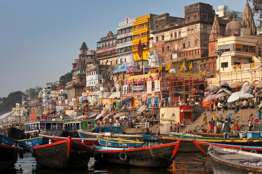 Tourist boats in The Ganges River at Dashashwamedh Ghat to watch Hindus bathing in Holy City of Varanasi, Benares, India