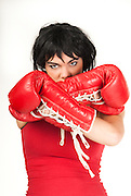 a young female boxer with red hand shoes, isolated in white