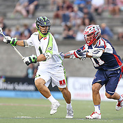 JoJo Marasco #1 of the New York Lizards tries to get past Matt Smalley #11 of the Boston Cannons with the ball during the game at Harvard Stadium on July 19, 2014 in Boston, Massachusetts. (Photo by Elan Kawesch)