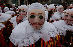 "BINCHE, BELGIUM - FEB-24-2004 - The Carnival of Binche was recently recognized by UNESCO as a ""Masterpiece of the Oral and Intangible Heritage of Humanity"". With roots going back to the Middle Ages, Binche's famed celebration ranks as one of Europe's oldest surviving street carnivals. The carnival culminates on Mardi Gras when the legendary Gille characters make their dramatic appearance. The day starts at 2 a.m. with the Gilles getting dressed in their homes and then parading through the streets collecting followers and stopping at the homes of other Gilles for snacks of raw oysters and champagne, before descending in mass on the town square."