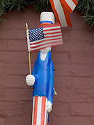A Lincoln doll holding an American flag