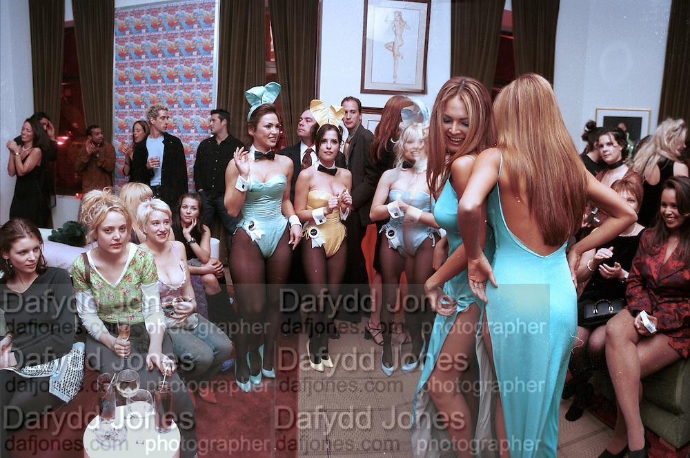 Bay Garnett and Emma Forrest. Playboy's rooftop lounge party. Playboy mansion. Fifth Ave. New York.2/7/99. New York. © Copyright Photograph by Dafydd Jones 66 Stockwell Park Rd. London SW9 0DA Tel 020 7733 0108 www.dafjones.com