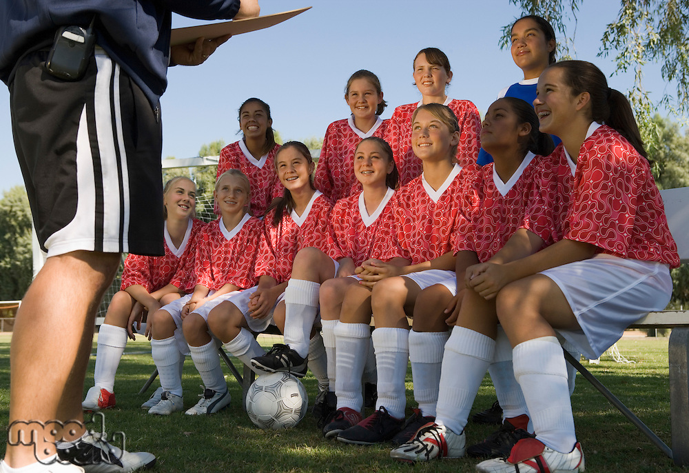 Girls Soccer Team Listening to Coach