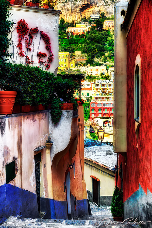 """""""Narrow passage to the Cathedral of Positano""""…<br /> <br /> After an exhilarating drive along the high cliffs on the Amalfi coast from Sorrento down to Positano, I found myself in sensory overload with its beauty and photogenic appeal.  After circling around the entire village and cliffside three times on Positano's only street, which was a single lane winding down from the top and back up and over to where I began…I finally found the parking garage by the hotel, about 2/3rds up the facing village in this image.  I began my descent from Hotel Montemare, which also has a great family restaurant on a large terrace overlooking the bay.  The climb down the winding road and steep staircases made for quite a workout in the hot late May sun.  The alleyways seemed to slip downward between every building and many maintained unique views of the sea, Duomo, town, or mountains of Positano."""