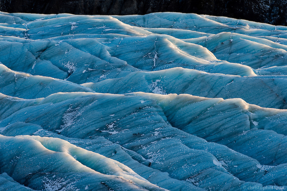 Svínafellsjökull Glacier Tounge, Southeast Iceland. Low angle sunlight in winter rims the crevasses of Svínafellsjökull Glacier.