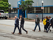 20 MAY 2019 - DAVENPORT, IOWA: PAUL RUMLER, left,  CEO of Quad Cities Chamber of Commerce and BETO O'ROURKE walk through downtown Davenport during O'Rourke's tour of flood damage in the city. O'Rourke, running to be the 2020 Democratic nominee for the US Presidency, has made climate change a central part of his campaign. He toured flood damage in Davenport Monday. The Mississippi River flooded through downtown Davenport on April 30 and much of downtown is still recovering from the flood.       PHOTO BY JACK KURTZ