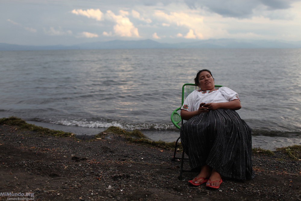 Human rights activist Maria Magdalena Choc, Q'eqchi' Mayan woman from the community of La Union, in El Estor, takes a break by the shore of Lake Izabal. Maria lived the community's 2006 and 2007 violent evictions at the hands of the Guatemalan Nickel Company (CGN), local subsidiary of then Canadian-owned Skye Resources. Maria is the sister-in-law of the slain teacher and La Union community leader Adolfo Ich Chaman. El Estor, Izabal, Guatemala. May 30, 2012.
