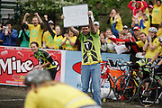 April 15, 2011:  Teter Cycling coach holds up a sign with the word History as their rider laps the field and repeats as winners of the Little 500 during the Women's Little 500 bicycle race held at Armstrong Stadium on the campus of Indiana University in Bloomington, IN.