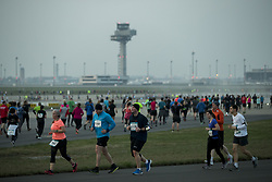 April 14, 2018 - Berlin, Germany - Athletes run during the 12th Airport Night Run at Berlin Brandenburg Airport in Schoenefeld, Germany on April 14, 2018. Over 6000 people attended this years's edition competing in the half marathon, 10 km distance and 4 x 4 km relay categories. (Credit Image: © Emmanuele Contini/NurPhoto via ZUMA Press)