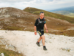 Noel Brady making his way up the reek during theie 24hr challenge...Pic Conor McKeown
