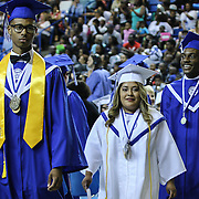 From Left: Howard graduates valedictorian Justin Peterson, salutatorian Bernice Espinoza and Brandon Gray participates in a processional during Howard High School of Technology 146th commencement exercises Thursday, June 04, 2015, at The Bob Carpenter Sports Convocation Center in Newark, Delaware.