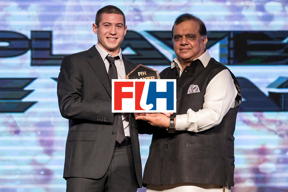 CHANDIGARH, INDIA - FEBRUARY 23: Dr. Narinder Dhruv Batra [R], President of The International Hockey Federation presents the FIH Male Player of the Year  award to John-John Dohmen [R] of Belgium during the FIH Hockey Stars Awards 2016 at Lalit Hotel on February 23, 2017 in Chandigarh, India. (Photo by Ali Bharmal/Getty Images for FIH)