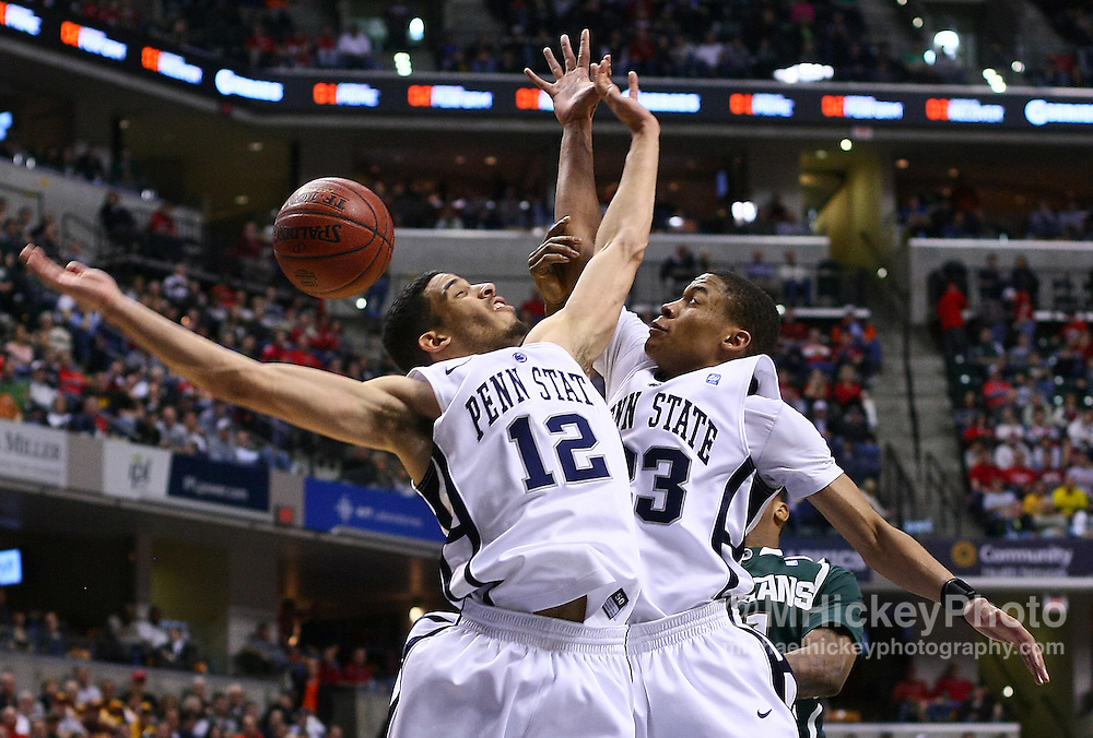March 12, 2011; Indianapolis, IN, USA; Penn State Nittany Lions guard Talor Battle (12) and Penn State Nittany Lions guard Tim Frazier (23) fight for a rebound against the Michigan State Spartans in the semi-final round of the 2011 Big Ten Tournament at Conseco Fieldhouse. Penn State defeated Michigan State 61-48. Mandatory credit: Michael Hickey-US PRESSWIRE