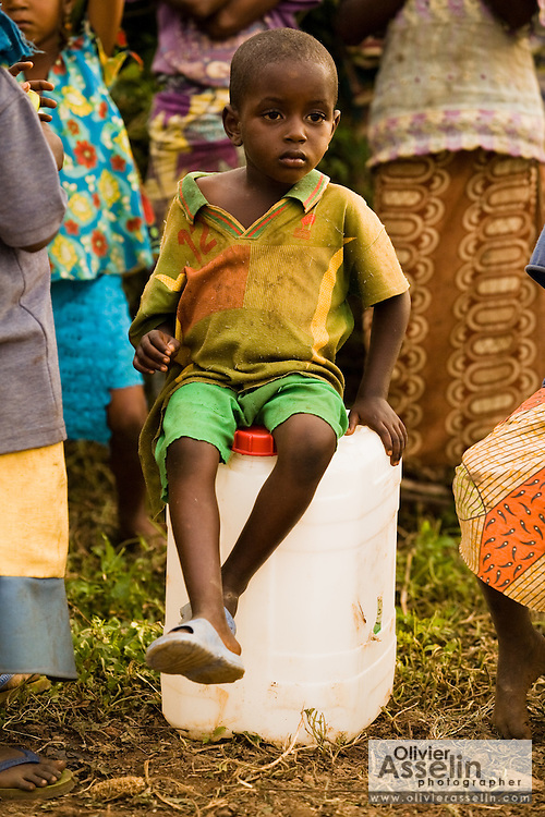 A refugee boy from Central African Republic sits on an empty jerican in the village of Boulembe, near Bertoua, Cameroon, on Tuesday September 15, 2009..
