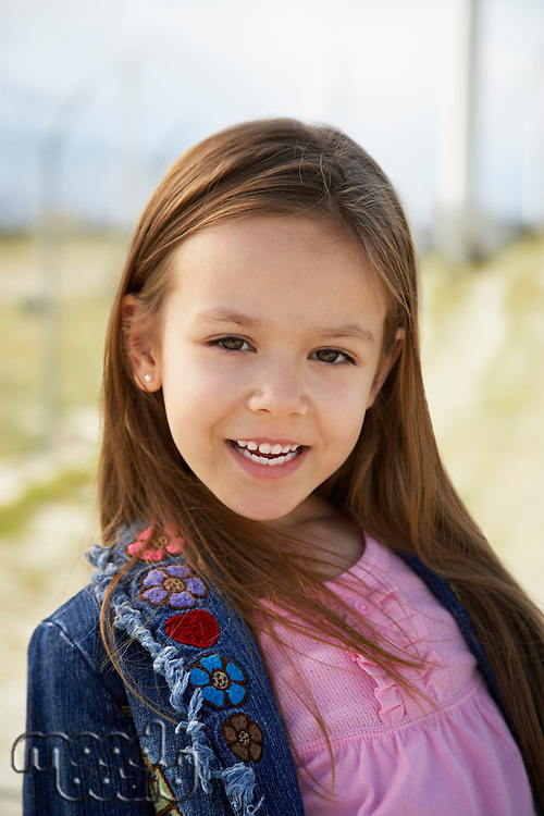 Girl (7-9) smiling, outdoors, portrait