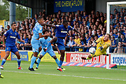 AFC Wimbledon defender Deji Oshilaja (4) with a chance during the EFL Sky Bet League 1 match between AFC Wimbledon and Coventry City at the Cherry Red Records Stadium, Kingston, England on 11 August 2018.