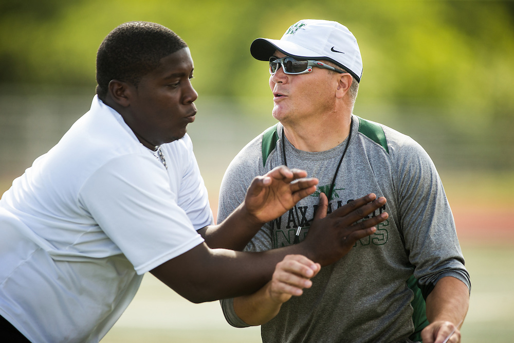 Waxahachie, Texas - September 5, 2015: Jon Kitna, Head Football Coach at Waxahachie High School, works on a blocking drill during a walk-through before the Indians' game against the Azle Hornets at Lumpkins Stadium in Waxahachie, Texas. (Darren Carroll for ESPN)
