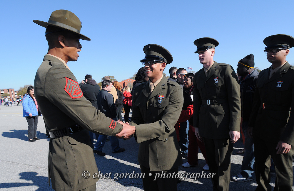 A Marine Corps Drill Instructor (left) congratulates his graduating Marines after a graduation ceremony at the Marine Corps Recruit Depot (MCRD) in Parris Island, SC  on Friday morning, March 15, 2013.