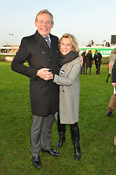 MARTIN CLUNES and JENNIFER SAUNDERS at the 2014 Hennessy Gold Cup at Newbury Racecourse, Newbury, Berkshire on 29th November 2014.  The Gold Cup was won by Many Clouds ridden by Leighton Aspell.
