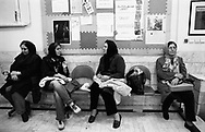 Mothers waiting and talking while their children are having music lessons in a private music school in Tehran. Iran, 2007