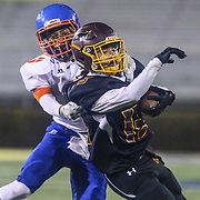 Milford TYREKE BENSON (13) is tackled from behind by Delmar DANTE TRADER (6) during the 2017 DIAA Division II state championship game between the Delmar and Milford Saturday, Dec. 02, 2017 at Delaware Stadium in Newark, DE.