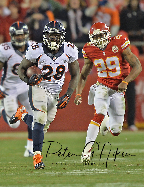 KANSAS CITY, MO - DECEMBER 01:  Running back Montee Ball #28 of the Denver Broncos rushes up field past safety Eric Berry #29 of the Kansas City Chiefs during the second half on December 1, 2013 at Arrowhead Stadium in Kansas City, Missouri.  (Photo by Peter G. Aiken/Getty Images) *** Local Caption *** Montee Ball;Eric Berry