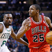 13 February 2013: Chicago Bulls point guard Marquis Teague (25) drives past Boston Celtics power forward Jeff Green (8) during the Boston Celtics 71-69 victory over the Chicago Bulls at the TD Garden, Boston, Massachusetts, USA.