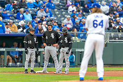 March 29, 2018 - Kansas City, MO, U.S. - KANSAS Kansas City, MO - MARCH 29: Kansas City Royals relief pitcher Burch Smith (64) warms up as the Chicago White Sox look on from third base during the major league opening day game on March 29, 2018 at Kauffman Stadium in Kansas City, Missouri. (Photo by William Purnell/Icon Sportswire) (Credit Image: © William Purnell/Icon SMI via ZUMA Press)