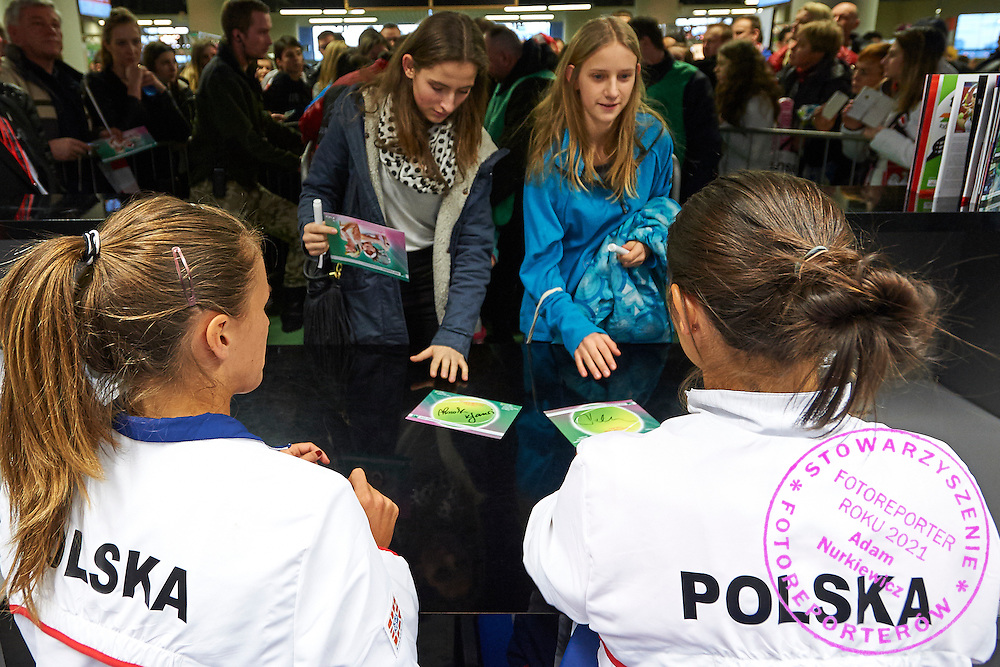 (L) Alicja Rosolska and (R) Klaudia Jans Ignacik both from Poland while their autographs session for supporters during Second Day of the Fed Cup / World Group 1st round tennis match between Poland and Russia at Tauron Krakow Arena on February 8, 2015 in Cracow, Poland.<br /> <br /> Poland, Cracow, February 8, 2015<br /> <br /> Picture also available in RAW (NEF) or TIFF format on special request.<br /> <br /> For editorial use only. Any commercial or promotional use requires permission.<br /> <br /> Adam Nurkiewicz declares that he has no rights to the image of people at the photographs of his authorship.<br /> <br /> Mandatory credit:<br /> Photo by &copy; Adam Nurkiewicz / Mediasport