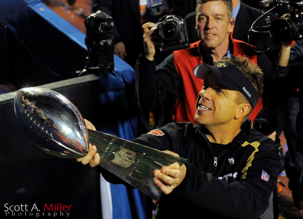 Feb 7, 2010; Miami, FL, USA; New Orleans Saints head coach Sean Payton takes a victory lap with the Lombardi Trophy after Super Bowl XLIV against the Indianapolis Colts at Sun Life Stadium. ©2010 Scott A. Miller