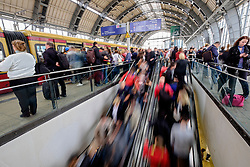 Blurred motion image of passengers on platforms at Alexanderplatz railway station on the S-Bahn in Berlin Germany