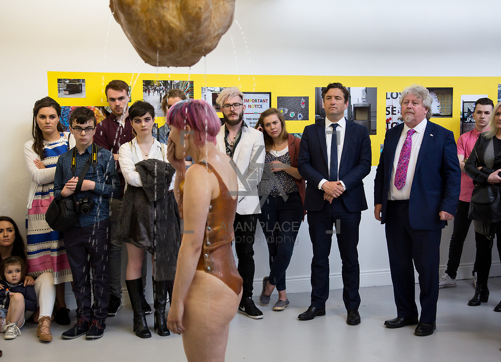 11.06.2017         <br /> International award winning artists are among the almost 200 graduates of Limerick School of Art and Design who's work went on exhibition at the LSAD Graduate Show 2017.<br /> <br /> John Concannon, Director of Creative Ireland and Mike Fitzpatrick, Head LSAD watch 4th year graduating Sculpture and Combined Media  student, Saerlaith Molloy performing her work titled 'Gurgle'.<br />  <br /> Students from the college took control of the over-riding message of this historical show as they conceptualised, designed and delivered on the theme - be.cause.<br />  <br /> The hypothesis conceived by Graphic Design graduates Cassandra Walsh and David Reilly, is derived from the fact the graduates have now reached a stage where they are confident with their work, their interpretations and creative solutions. As creative minds they have an innate need to &ldquo;do&rdquo; something. There is just this need to create, be.cause.<br /> . Picture: Alan Place.