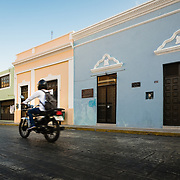 Motorbike speeding past colonial architecure in Merida, Mexico