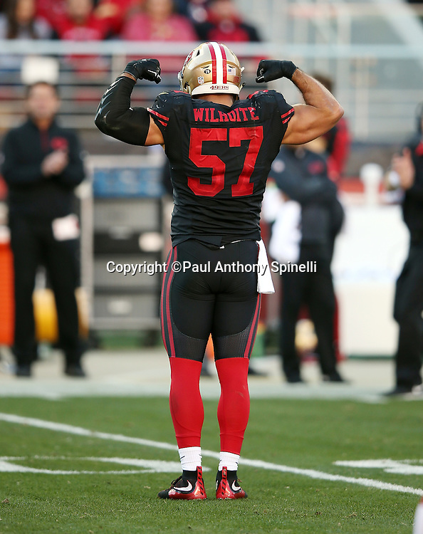 San Francisco 49ers inside linebacker Michael Wilhoite (57) flexes his muscles after making a play that forces a punt during the 2015 week 12 regular season NFL football game against the Arizona Cardinals on Sunday, Nov. 29, 2015 in Santa Clara, Calif. The Cardinals won the game 19-13. (©Paul Anthony Spinelli)