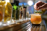 Washington, D.C. - March 06, 2018: Lucy Dunning, bar manager of 2 Birds 1 Stone, makes one of the D.C. bar's signature pineapple based drinks Our Lady of the Harbor, made with Teeling Irish whiskey, Green Chartreuse, Pineapple, Lime, and Angostura bitters. <br /> <br /> <br /> CREDIT: Matt Roth for The New York Times<br /> Assignment ID: 30217237A