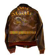 "This type A-2 flight jacket belonged to Merle Childress, a ball turret gunner attached to the 570th Squadron of the 390th Bomb Group. Childress flew 25 missions over Europe, which is signified by the 25 bombs painted on the bottom portion of the back of the jacket. Above the bombs is the name of his plane ""Hey Moitle"" written above a painting of a B-17 flying in front of a cloud. The front of the jacket is plain, but there is a circular pattern on the left breast where the squadron patch would have been sewn to the jacket."