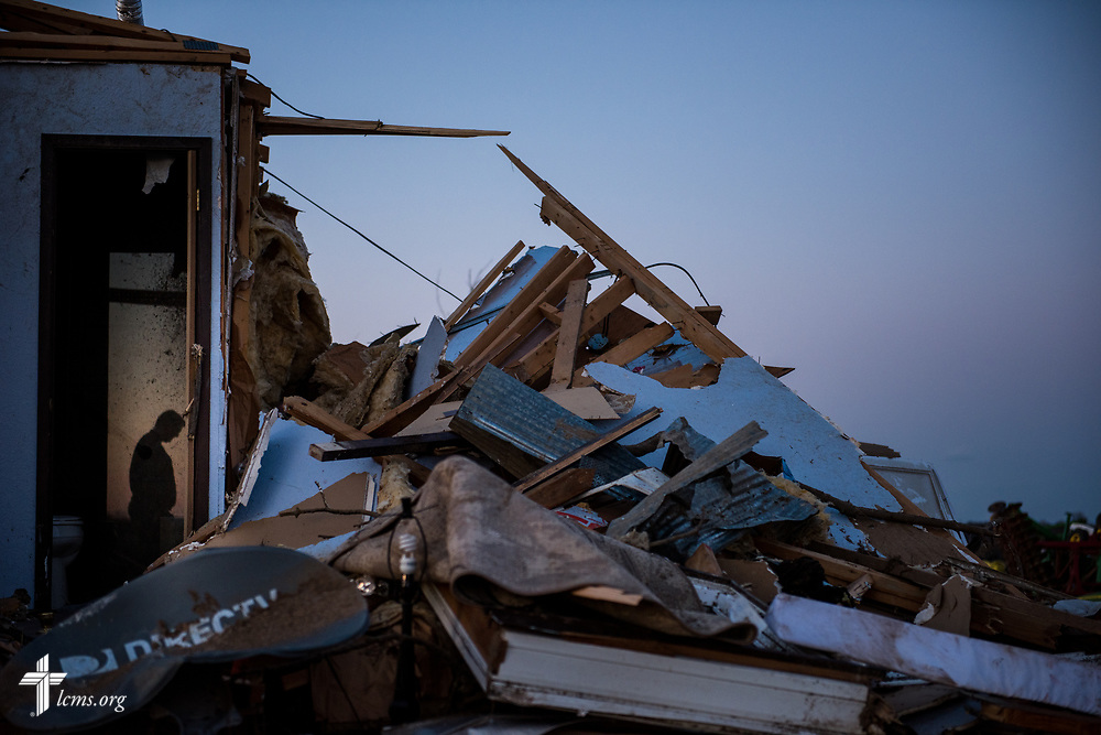 The Rev. Ross Johnson, director of LCMS Disaster Response, surveys a church member's destroyed home on Wednesday, March 1, 2017, in Perryville, Mo. The night before, violent tornadoes ripped through parts of the town. LCMS Communications/Erik M. Lunsford