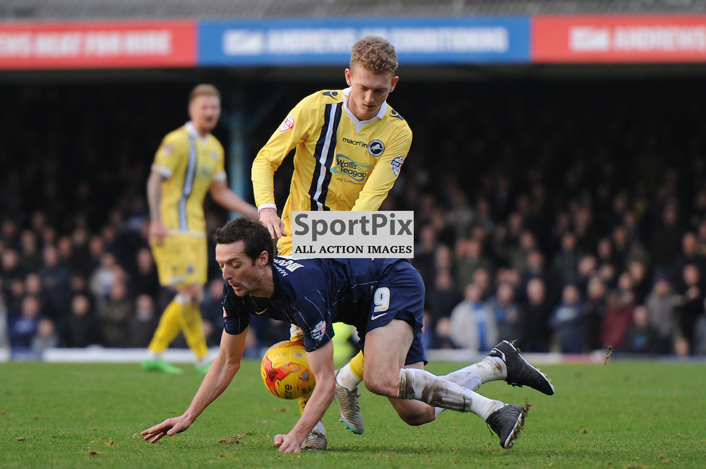 Southends David Mooney and Millwalls George Saville in action during the Southend v Millwall game in the Sky Bet League 1 on the 28th December 2015.
