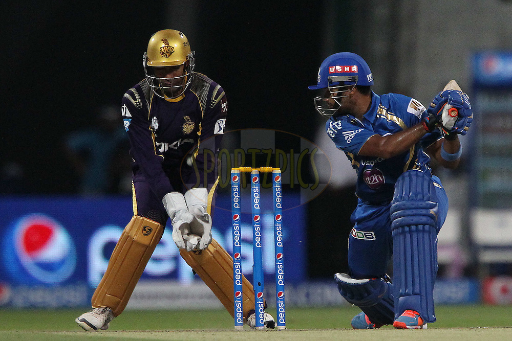 Aditya Tare of the Mumbai Indians takes a swing and a miss during match 1 of the Pepsi Indian Premier League Season 7 between the Mumbai Indians and The Kolkata Knight Riders held at the Sheikh Zayed Stadium, Abu Dhabi, United Arab Emirates on the 16th April 2014<br /> <br /> Photo by Ron Gaunt / IPL / SPORTZPICS