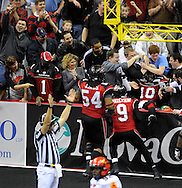 Cleveland's Otis Amey, 10, is surrounded by fans after leaping into the seats after scoring a touchdown  during the Gladiators' 61-48 win in their Arena Football League debut on March 3, 2008 at Quicken Loans Arena in  Cleveland against visiting New York Dragons.Ryan Bowers is also in on the play.