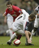 Photo: Aidan Ellis.<br /> Bolton Wanderers v Blackburn Rovers. The Barclays Premiership. 04/03/2007.<br /> Blackburn's  Matt Derbyshire tangles with Bolton's Henrikm Pedersen