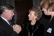 Nicholas Ferguson  (Chairman Courtauld Institute of Art)  and Lily Safra, Celebration honouring the arrival of Deborah Swallow, director, Courtauld Institute of Art. Courtauld Gallery. Somerset House. 9 December 2004. ONE TIME USE ONLY - DO NOT ARCHIVE  © Copyright Photograph by Dafydd Jones 66 Stockwell Park Rd. London SW9 0DA Tel 020 7733 0108 www.dafjones.com