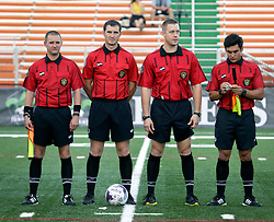 27 June 2015. New Orleans, Louisiana.<br /> National Premier Soccer League. NPSL. <br /> Jesters 1- Georgia Revolution 5.<br /> Referees prepare for the New Orleans Jesters v Georgia Revolution at home in the Pan American Stadium. <br /> Photo©; Charlie Varley/varleypix.com