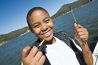 Boy Enjoying Fishing on Lake